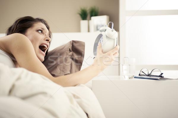 Сток-фото: расстраивать · женщину · будильник · дома · женщины