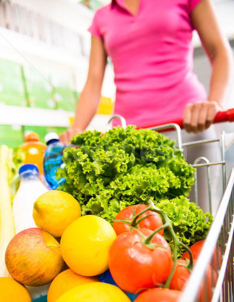 Shopping cart filled with vegetables and fruit Stock photo © stokkete