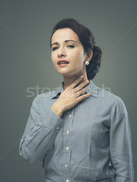 Mulher garganta inflamada vintage tocante pescoço jovem Foto stock © stokkete