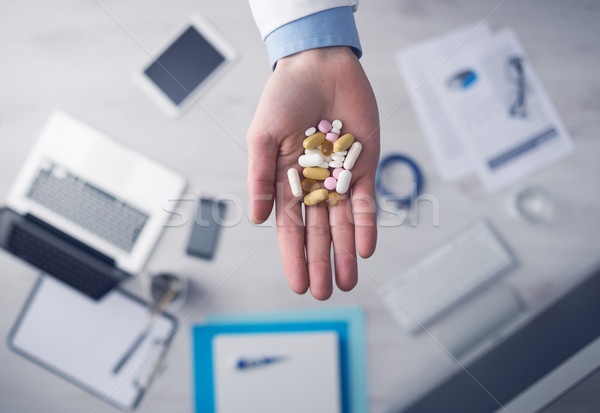 Stock photo: Doctor giving a lot of pills