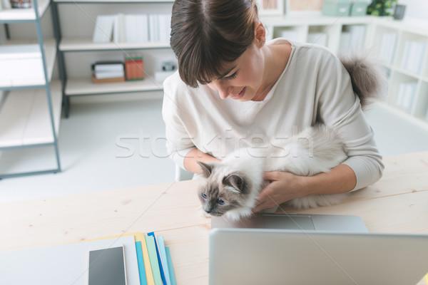 Woman cuddling her cat Stock photo © stokkete