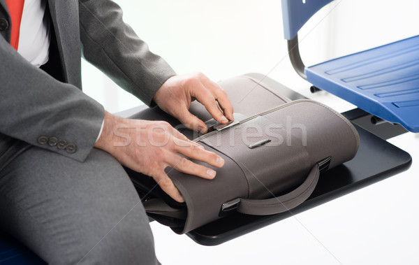 Corporate businessman opening his bag Stock photo © stokkete