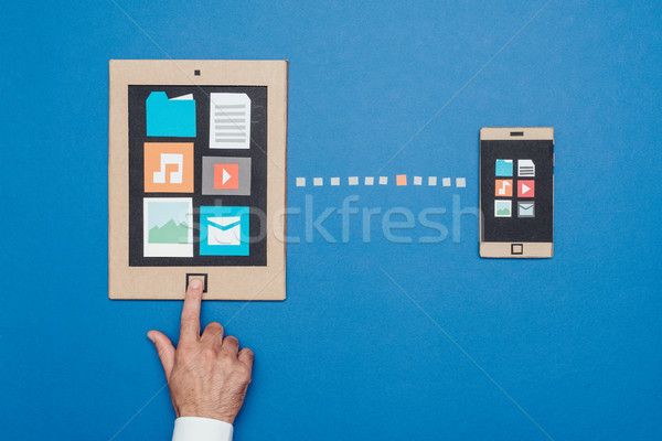 Data sync on cardboard devices Stock photo © stokkete