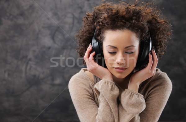young woman enjoying music Stock photo © stokkete