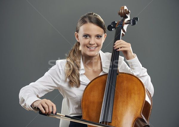 Belo violoncelista sorridente mulher jovem cinza feliz Foto stock © stokkete
