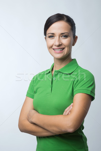 Smiling woman in green polo t-shirt Stock photo © stokkete