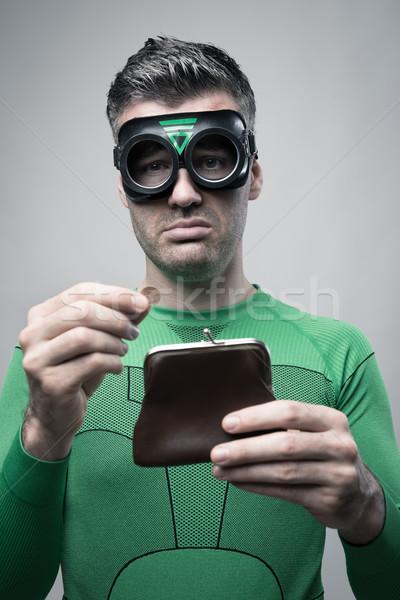 Pénztelen szuperhős üres pénztárca lehangolt tart Stock fotó © stokkete