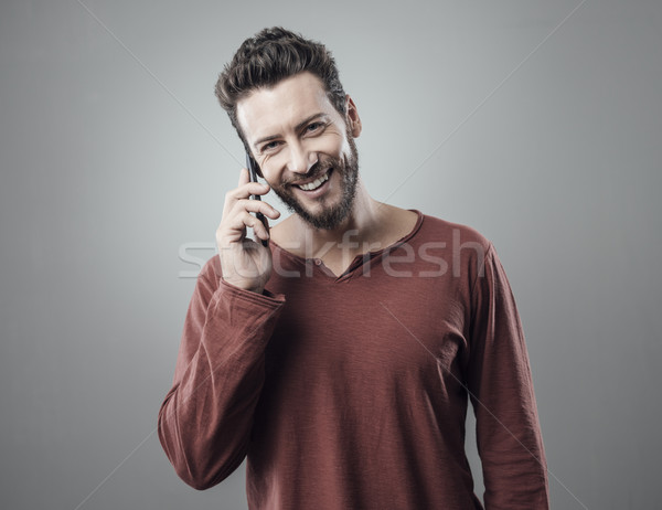 Young man having a phone call Stock photo © stokkete