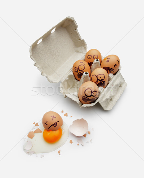 Eggs in a box are scared of dead friend Stock photo © stokkete