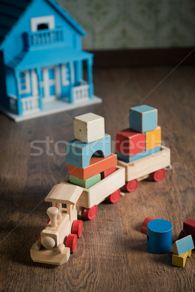 Wooden toy train and doll house Stock photo © stokkete