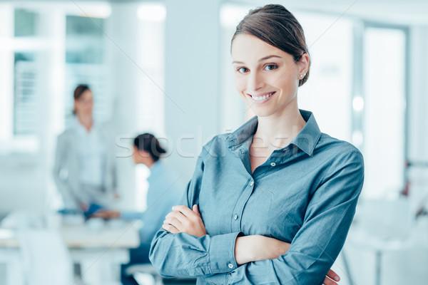 Smiling female office worker portrait Stock photo © stokkete