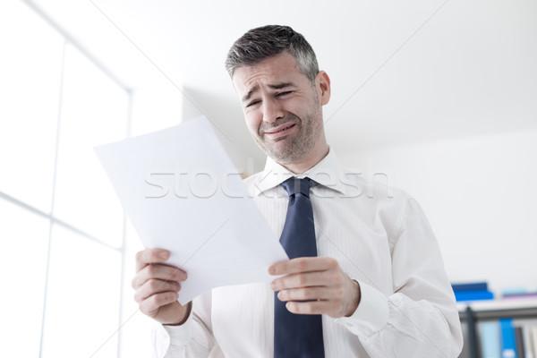 Office worker receiving a dismissal letter Stock photo © stokkete