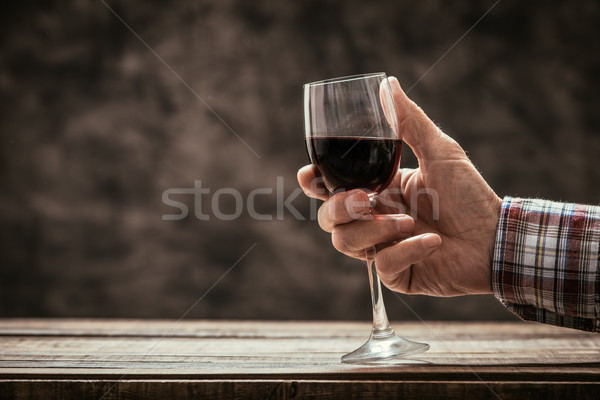 Man tasting a glass of red wine Stock photo © stokkete
