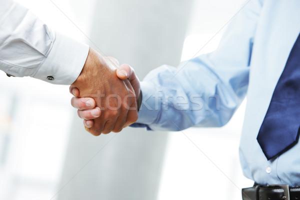 Empresários aperto de mãos negócio tratar aperto de mão Foto stock © stokkete