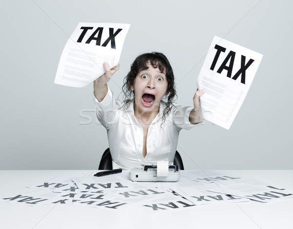 Woman frightened by taxes Stock photo © stokkete