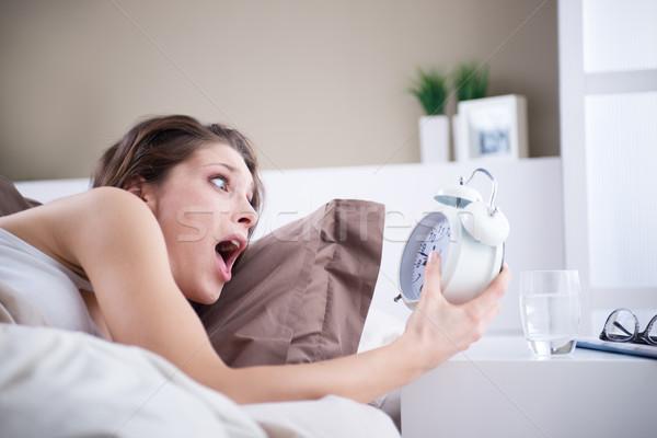 расстраивать женщину будильник дома женщины Сток-фото © stokkete