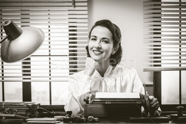 Sorridente secretário trabalhar 1950 estilo trabalhando Foto stock © stokkete