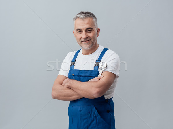 Plumber posing with a wrench Stock photo © stokkete