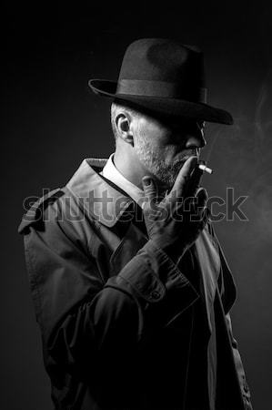 Man holding a gun Stock photo © stokkete