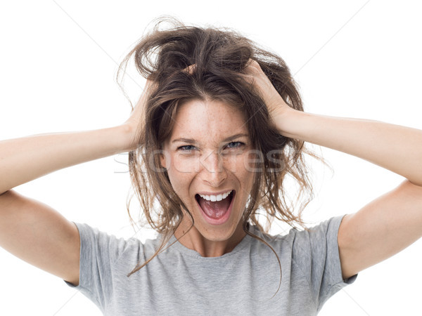 Angry woman having a bad hair day Stock photo © stokkete