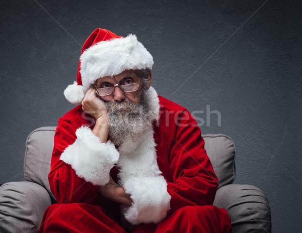 Nudzić Święty mikołaj fotel leniwy strony Zdjęcia stock © stokkete