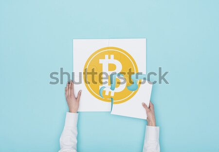 Woman completing a puzzle with a bitcoin icon Stock photo © stokkete