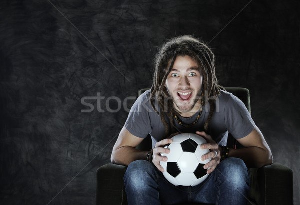 Watching soccer on tv Stock photo © stokkete