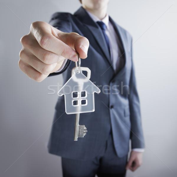 új ház fiatal üzletember ház kulcsok ingatlan Stock fotó © stokkete