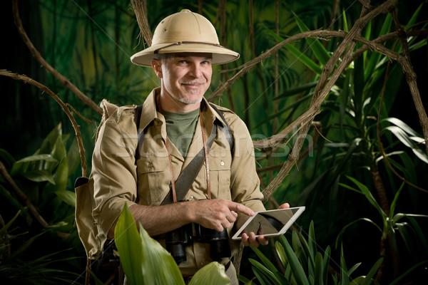 интернет доступ улыбаясь авантюрист джунгли Сток-фото © stokkete