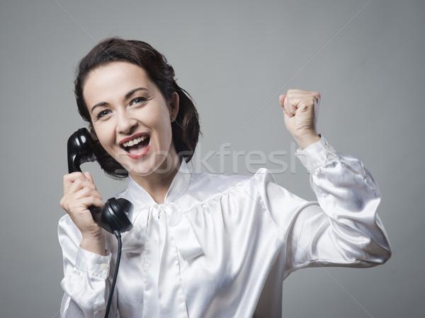 Secrétaire téléphone vintage bonnes nouvelles poing Photo stock © stokkete