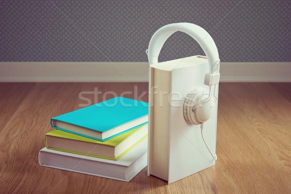 Könyv fehér fejhallgató keményfedeles keményfa padló régi tapéta Stock fotó © stokkete
