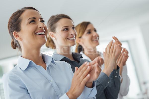 ビジネス 女性 拍手 笑みを浮かべて 成功 ストックフォト © stokkete