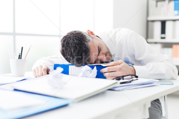 Manager sleeping on his desk Stock photo © stokkete
