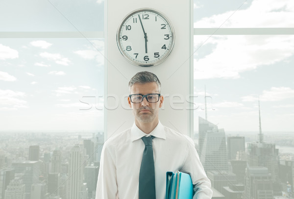 Frustrated businessman standing under a clock Stock photo © stokkete