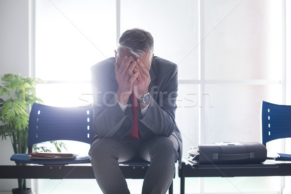 Desperate businessman in the waiting room Stock photo © stokkete