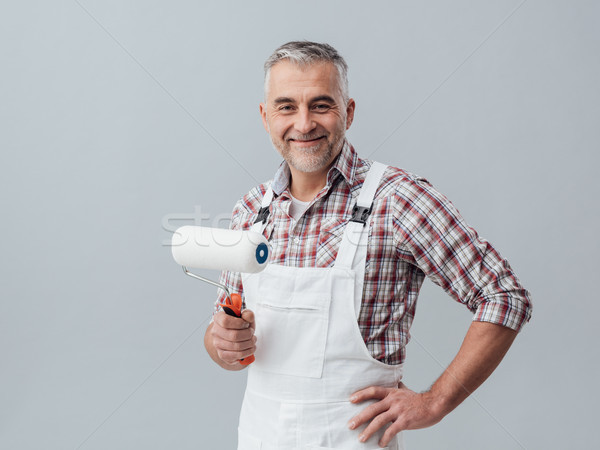 Painter posing with a paint roller Stock photo © stokkete