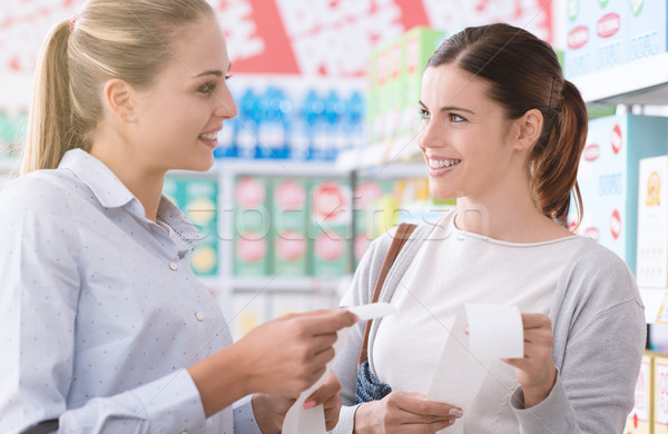 Women comparing grocery receipts Stock photo © stokkete