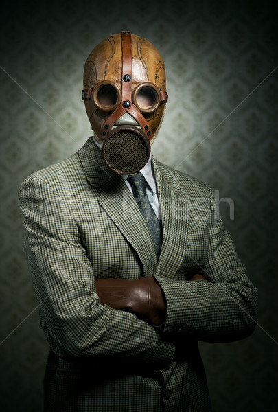 Vintage businessman wearing gas mask Stock photo © stokkete