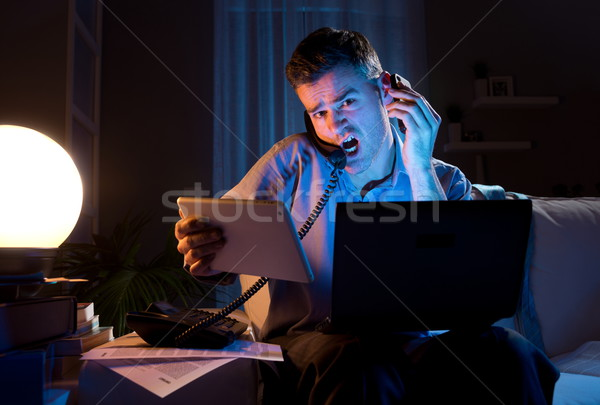 Businessman working overtime at home Stock photo © stokkete