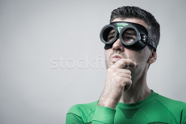 Pensive superhero with hand on chin Stock photo © stokkete