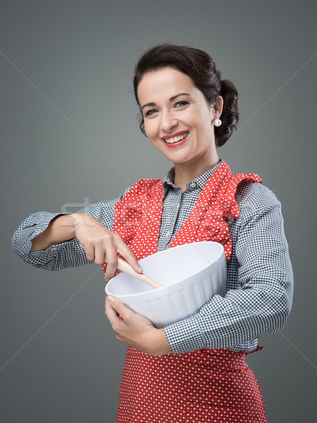Cook mixing ingredients in a bowl Stock photo © stokkete