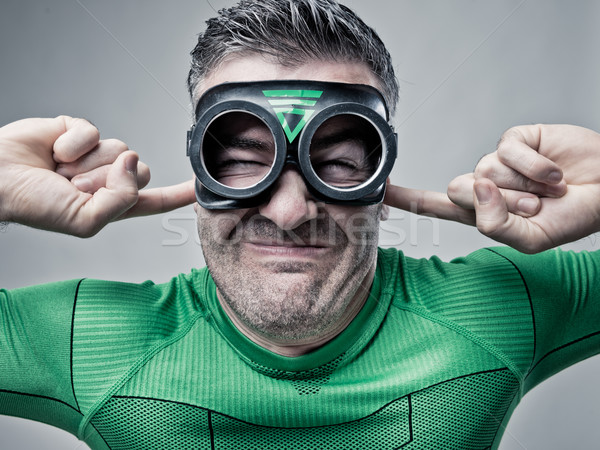 Superhero plugging ears with fingers Stock photo © stokkete