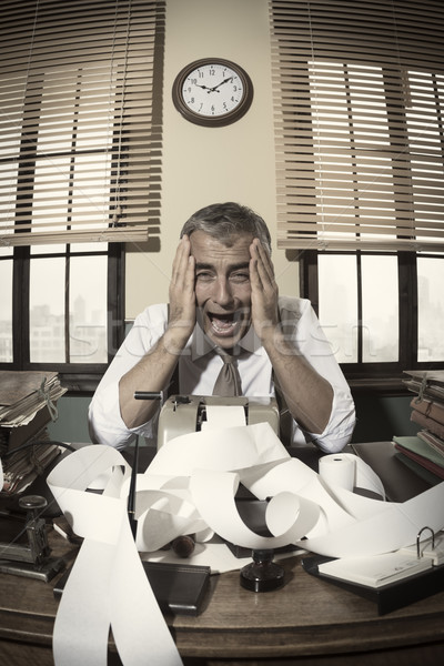 Stock photo: Desperate accountant shouting head in hands in vintage office