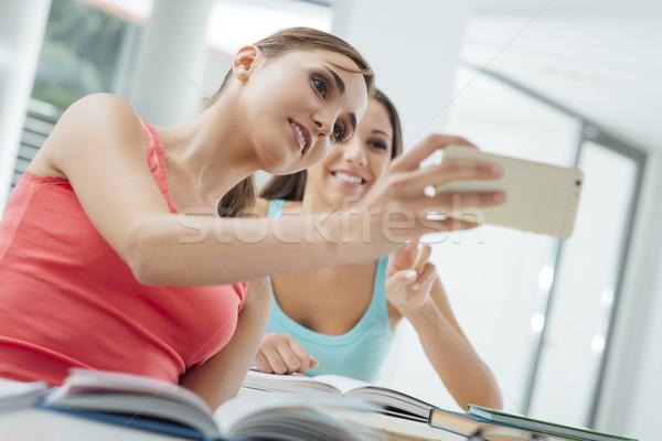 Smiling girls taking selfies at school Stock photo © stokkete