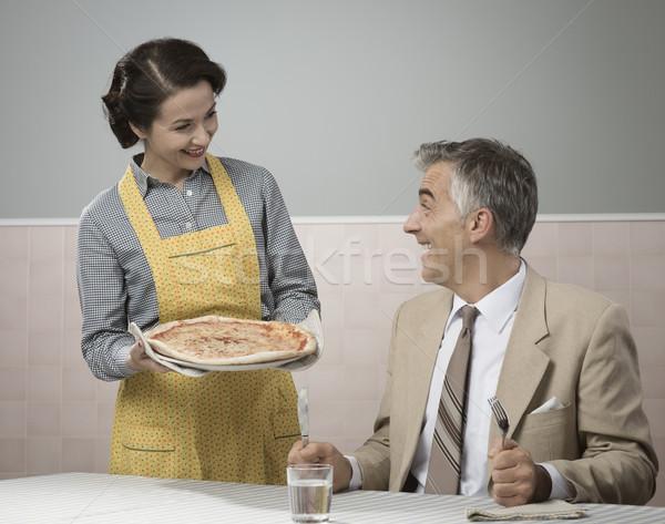 Smiling wife serving dinner Stock photo © stokkete
