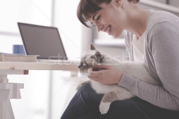 Woman cuddling her lovely cat Stock photo © stokkete
