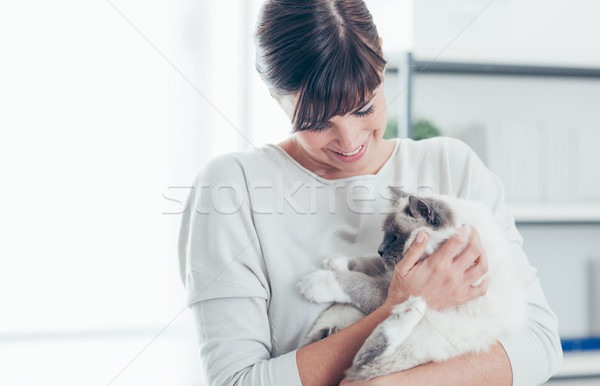 Pet owner with her cat Stock photo © stokkete