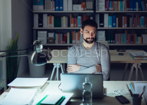 Pensive man in the office at night Stock photo © stokkete