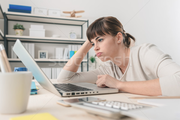 Disappointed woman working with a laptop Stock photo © stokkete