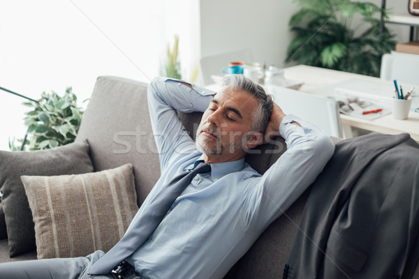 Businessman sleeping on the couch Stock photo © stokkete